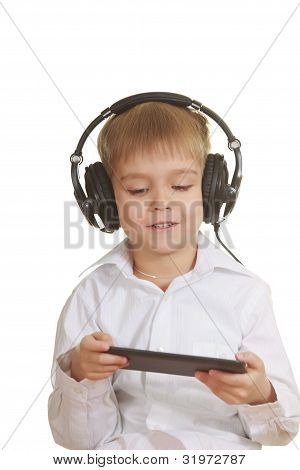 Boy With Electronic Pad And Phones