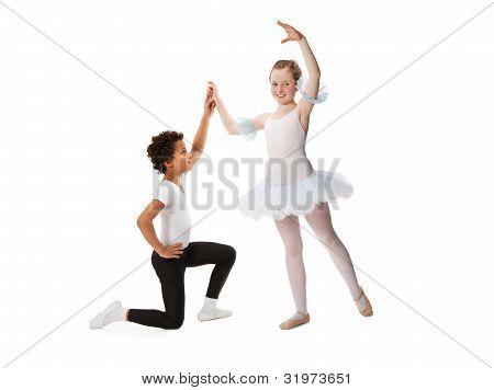 interracial  children dancing together