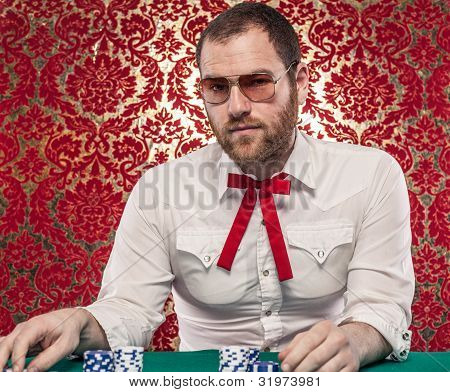 Confident Man Gambling Wearing Glasses, Texas Tie