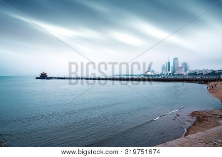 The Trestle Bridge By The Sea, The Qingdao City Landscape In The Fog.