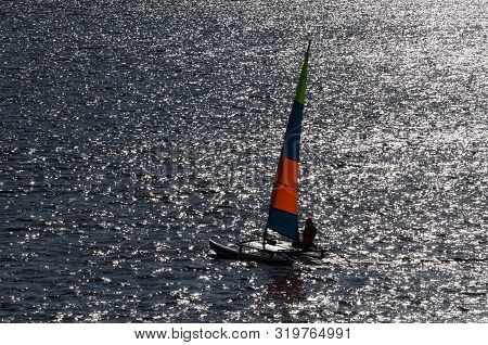 Regatta In Sunny Rays - Sailboat On The Waves Of The Lake