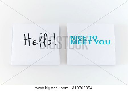 Hello, Nice To Meet You - Square Raw Chocolate Pieces On White Background