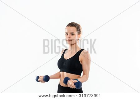 Young Sporty Blond Woman In A Black Sportswear Exercising With Hand Weights Isolated Over White Back