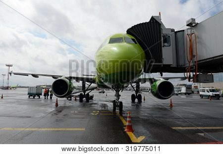 Moscow, Russia  April 26, 2018: Airbus A319 Airplane Of S7-siberia Airlines At A Passenger Telescopi