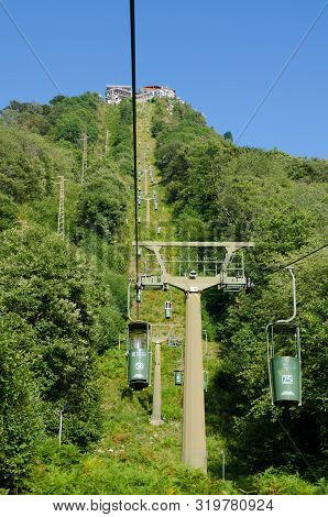 Laveno, Lake Maggiore, Italy. 16th August 2019. Riding The Bucket-lift Cablecar Up The Mountain Of S