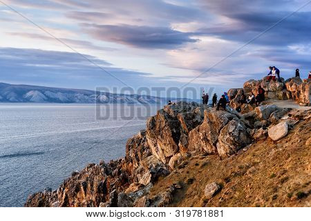 Irkutsk Region, Russia - September 16, 2017: People Watch A Beautiful Sunset On Spectacular Rocks In