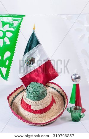 Little Hat, Cornet, Mexican Flag And Glass Of Tequila On White Background