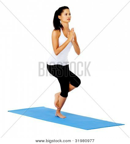 Young woman with yoga pose eagle. This is part of a series of various yoga poses by this model, isolated on white