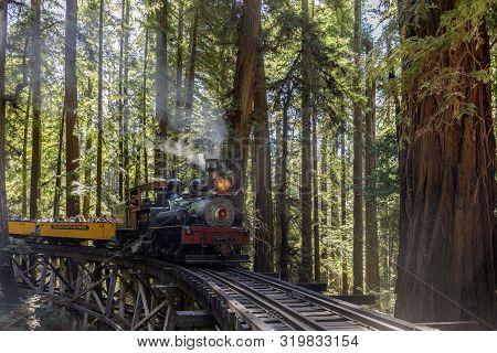 Felton, California - August 31, 2019:  Roaring Camp Dixiana Shay Steam Train Over Trestle Crossing R