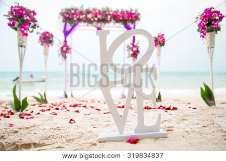 decorated arch for a beach wedding ceremony