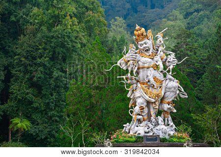 Ancient Statue Of Fighting Kumbhakarna Rakshasa From Epic Hindu Legend Ramayana In Bedugul Botanical