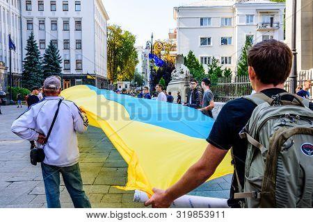 Kiev, Ukraine - August 23, 2019: People With A Huge Ukrainian Flag Near Administration Of President