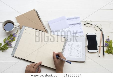 Hand Of Woman Working With Saving Account Passbook Bank ,statement Due Expenses Of Credit Card ,cale