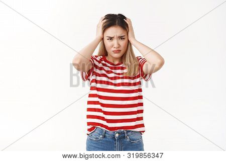 Girl cannot stand complicated troublesome situations. Perplexed pressured young female student hard take decision hold hands head frowning intense migraine feel headache troubled white background poster