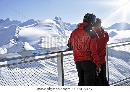 Skiers Enjoying The Winter Mountain Panorama At Kitzsteinhorn Peak, Austria