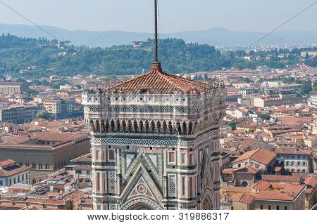 Famous Giotto Campanille With Tourists And Florence Cityscape. Florence, Italy