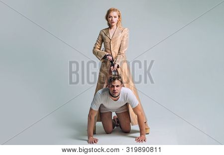 Dominantning. Woman And Man Playing Domination Games. Love Relations And Dominating. Concept Of Sexu