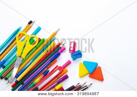 Felt-tip Pens And Pencils On A White Background. Stationery Layout. School Theme. Preparing For Scho