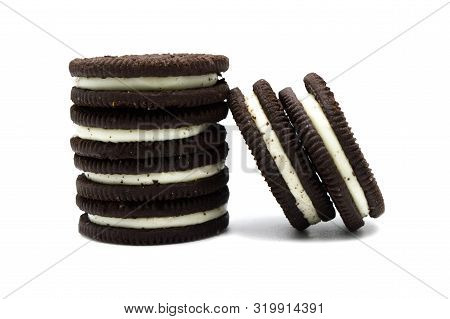 Oreo Biscuits Isolated On White Background. It Is A Double Stuf Chocolate Sandwich Cookies With Vani