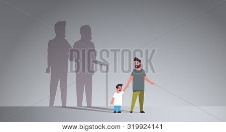 Father With Son Holding Hands Dreaming About Future Shadow Of Young And Mature Man Standing Together