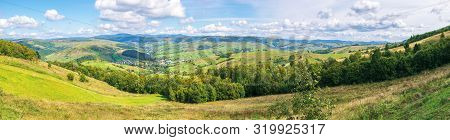 Panorama Of A Countryside In Early Autumn. Village On The Hillside, Mountain Ridge In The Distance.
