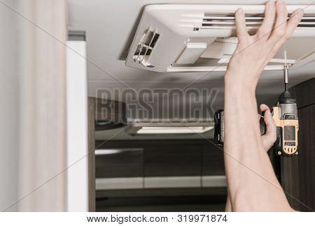 Rv Recreational Vehicle Air Conditioner Installation. Caucasian Technician Installing Cooling Unit I