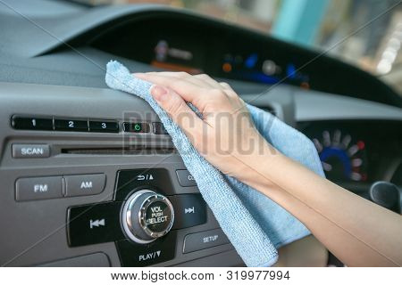 Hand Cleaning Interior Modern Car With Microfiber And Cleaning Console Car.
