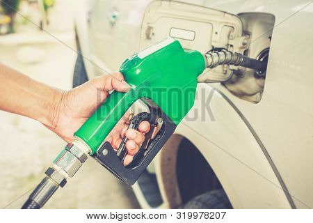 Hand Refilling Worker Fuel The Car At The Refuel Station.