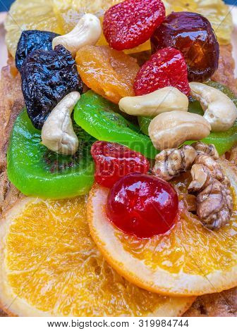 Closeup Colorful Fruitcake Pasted With Sweetend Fruits.