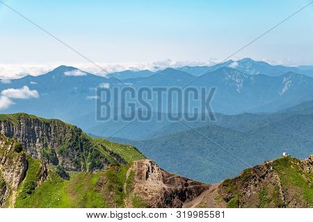 Anti-avalanche Cannon And Meteorological Station At The Top Of A Mountain Range. Green Vegetation In