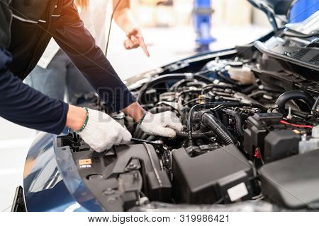 Mechanic Asian Man Examining And Maintenance To Customer The Engine A Vehicle Car Hood, Safety Inspe