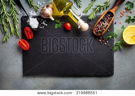 Culinary Background With Kitchen Slate Board And Aromatic Spices. Empty Place For Menu Or Recipe. To