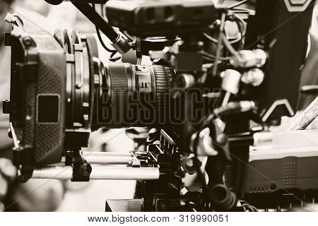 Film industry. Filming with professional camera background poster