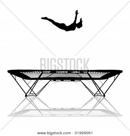 silhouette of female gymnast on trampoline