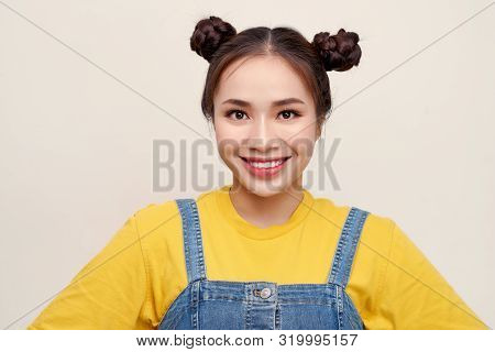 Portrait Of Young Asian Woman Wearing  Jeans Dungaree On White Background