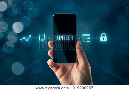 Fintech (financial Technology) On Smart Phone Concept. Hand With Smart Phone And Text Fintech And Fi