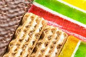 close-up photo of waffle and colorful jelly background poster
