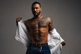 Handsome Bearded Man. Confidence Charisma. Muscular Macho Man With Athletic Body. Sport And Fitness,