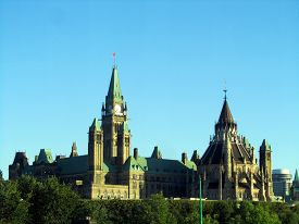 Parliament Of Canada Under A Clear Blue Sky In The Evening Near Sunset On Parliament Hill In Ottawa,
