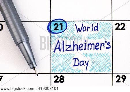 Reminder World Alzheimer's Day In Calendar With Pen. September 21