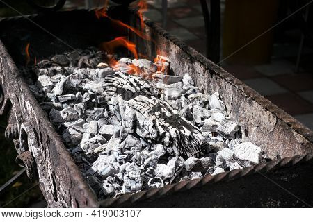 Burning Charcoal And Log In A Bbq Brazier. Close-up.