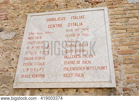 Rieti, Ri, Italy - August 18, 2020:  Panel With The Inscription Navel Of Italy In Many Languages In