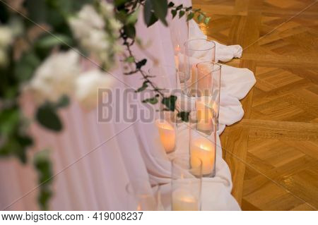 Main Table At A Wedding Reception With Beautiful Fresh Flowers And Candles. Close Up.