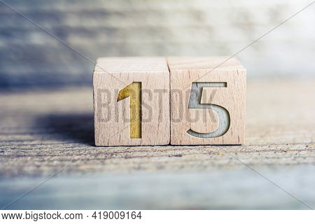 Number 15 Formed By Wooden Blocks On A Board