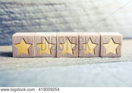 5 Star Ranking Formed By Wooden Blocks On A Board - Quality Concept