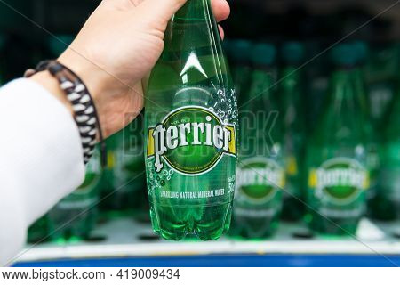 Tyumen, Russia-april 21, 2021: Mineral Water Bottles Perrier. French Brand Of Premium Mineral Water.