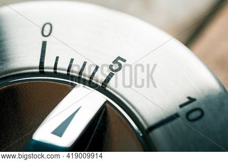 5 Minutes - Macro Of An Analog Metal Timer On A Wooden Floor