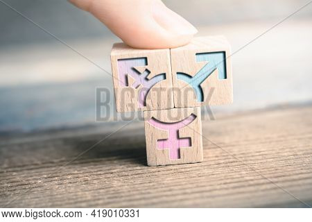 Transgender, Lgbt Or Intersex Icon On 3 Wodden Blocks On A Board Arranged By A Finger