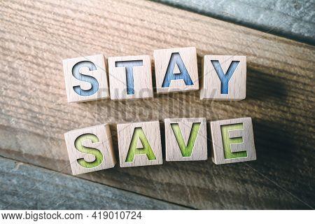 Stay Save Written On Wooden Blocks On A Board