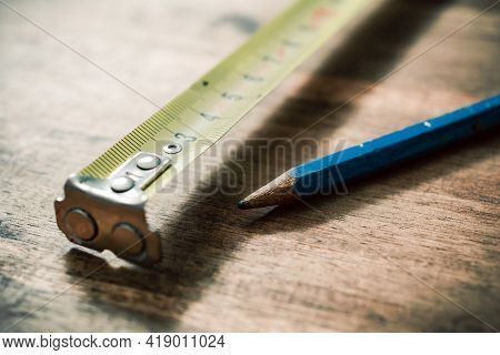 Pencil And Measuring Tape On An Vintage Wooden Table
